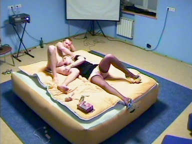 Blonde dish is fixed on the air bed and sucksthe cock