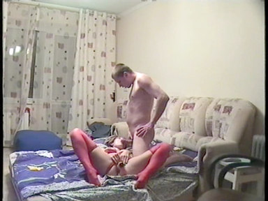 Girl is pushing the dildo inside, already having a cock in her mouth